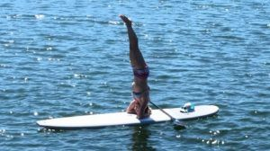 headstand on a paddleboard